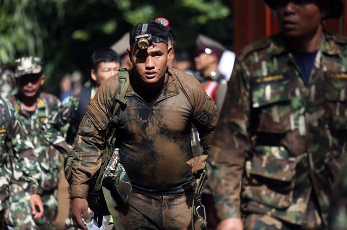 Thai soldiers searching for the missing children and their coach march out of the Tham Luang Nang Non cave in Mae Sai, Chiang Rai on Friday, June 29. (AP Photo/Sakchai Lalit)