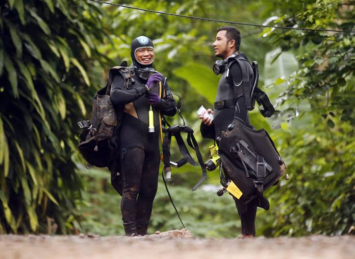 Thai rescuers prepare for diving July 3, after the 12 boys and their soccer coach were found alive. (AP Photo/Sakchai Lalit)
