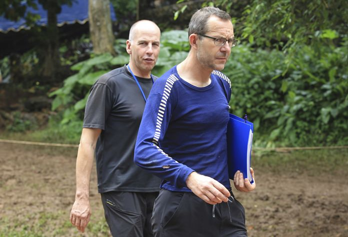 Richard Stanton, left, and John Volanthen arrive in Mae Sai Tuesday, July 3. The two British divers first found the 12 boys and soccer coach on Monday, July 2. They recorded video of the boys talking with them. (AP Photo)