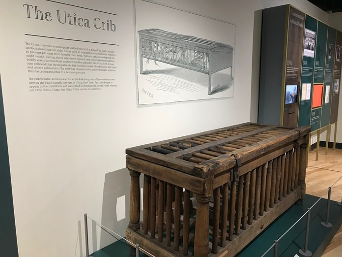 In this June, 29, 2018, photo, a cage for humans known as the Utica Crib is displayed at the National Museum of Psychology in Akron, Ohio. It was used in early asylums to restrain mental patients in their beds. (AP Photo/Mitch Stacy)