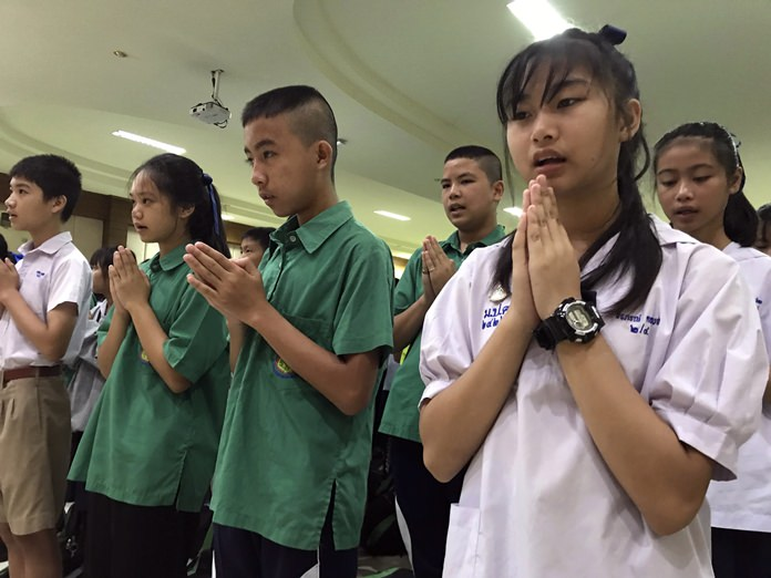 Students pray at Maesaiprasitsart School where six out of the rescued 12 boys study as they cheer the successful rescue July 11. (AP Photo/Johnson Lai)