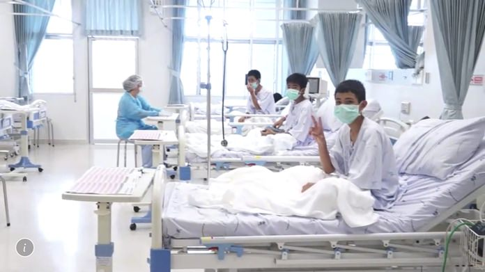 In this image made from video, released by the Thailand Government Spokesman Bureau, three of the 12 boys are seen recovering in their hospital beds after being rescued along with their coach from a flooded cave in Mae Sai, Northern Thailand. (Thailand Government Spokesman Bureau via AP)