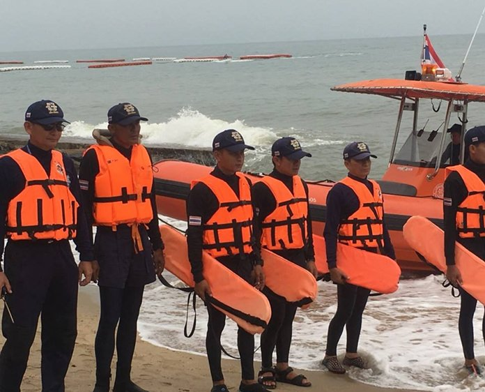 Pattaya Municipal Police check up on boats and sea operators along the shores of Pattaya and the pier after the Phuket tragedy.