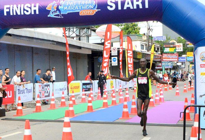 Bernard Kiplangat Kibilo of Kenya crosses the finish line to win the men's marathon, Sunday July 15.