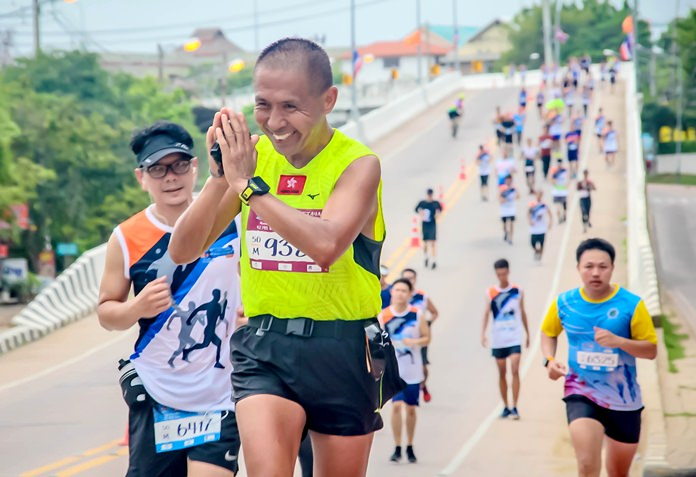 A runner thanks spectators for their support on his way around the marathon course.