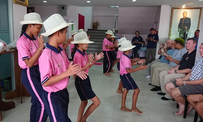 Children perform a talent show for the visitors.