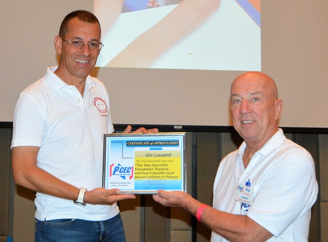 MC Roy Albiston presents the PCEC's Certificate of Appreciation to Gio Luicardi for his informative and interesting talk.