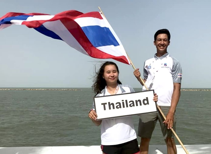 Arthit Romanyk (Miki) holds the Thai flag as he poses with his sister Janisara Romanyk (Sasha) at the 48th Youth Sailing World Championships in Corpus Christi, Texas.