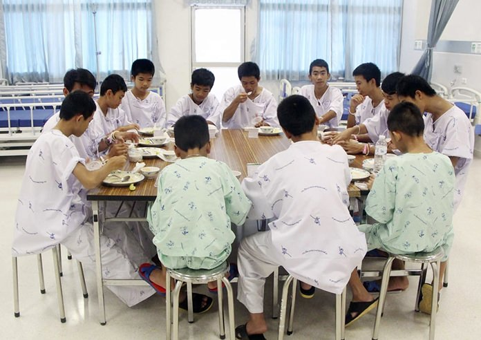 The rescued soccer team members eat a meal together at a hospital in Chiang Rai, northern Thailand. (Thailand's Ministry of Health and the Chiang Rai Prachanukroh Hospital, via AP, File)