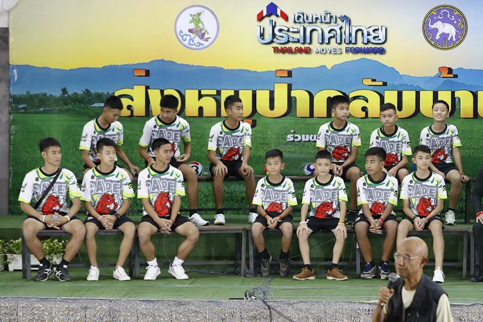 Members of the rescued soccer team and their coach sit during a press conference discussing their ordeal. (AP Photo/Vincent Thian)