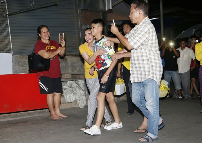 Relatives of Duangpetch Promthep greet him as he arrives home in Mae Sai district, Chiang Rai. (AP Photo/Sakchai Lalit)