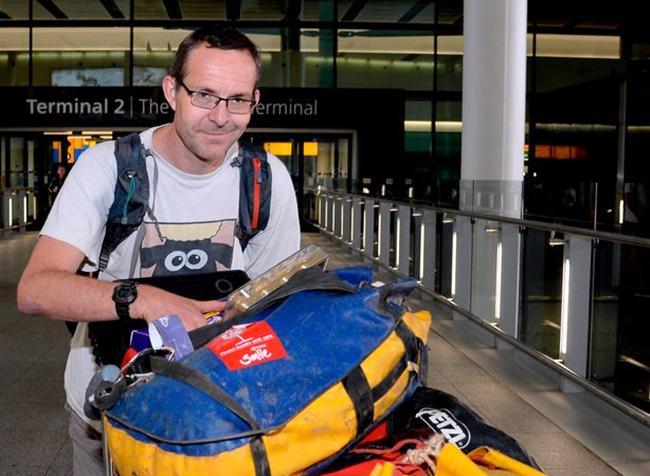 British diver John Volanthen smiles for the camera at Suvarnabhumi Airport in Bangkok.