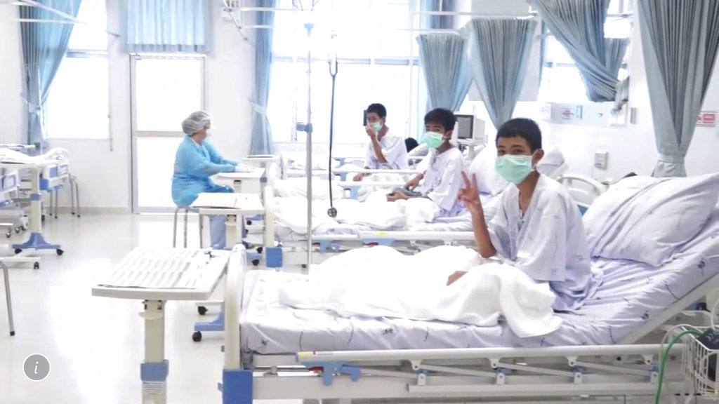 In this image made from video, three of the 12 boys are seen recovering in their hospital beds after being rescued along with their coach from a flooded cave in Mae Sai, Chiang Rai province, Wednesday, July 11. (Thailand Government Spokesman Bureau via AP)