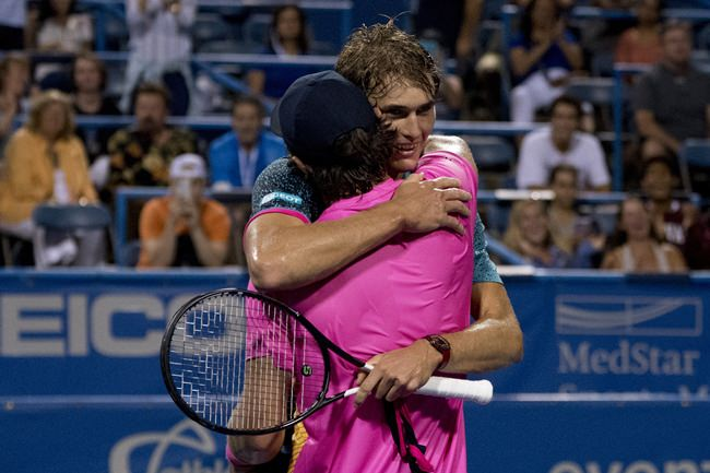 Alexander Zverev, of Germany, smiles as he hugs his brother Mischa Zverev, foreground, after defeating him 6-3, 7-5, during the Citi Open tennis tournament in Washington, Thursday, Aug. 2. (AP Photo/Andrew Harnik)