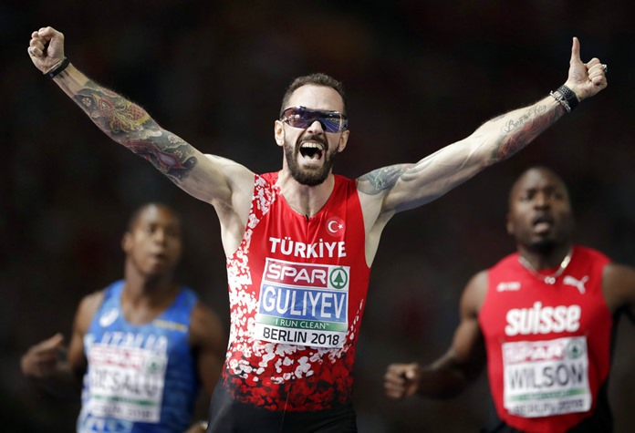 Turkey's Ramil Guliyev celebrates winning the men's 200 meter final race at the European Athletics Championships in Berlin, Germany, Thursday, Aug. 9. (AP Photo/Michael Sohn)