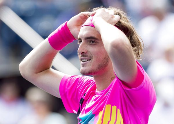 Stefanos Tsitsipas, of Greece, celebrates after defeating Novak Djokovic, of Serbia, at the Rogers Cup men's tennis tournament in Toronto, Thursday, Aug. 9. (Frank Gunn/The Canadian Press via AP)