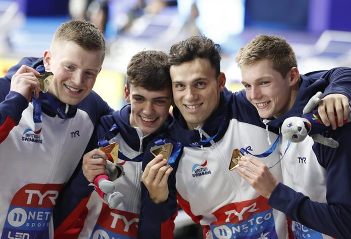 From left, Adam Peaty, Nicholas Pyle, James Guy, Duncan W Scott, of Great Britain, pose with their gold medals after the quartet won the 4 X 100 meters medley relay men's final at the European Swimming Championships in Glasgow, Scotland, Thursday, Aug. 9. (AP Photo/Darko Bandic)