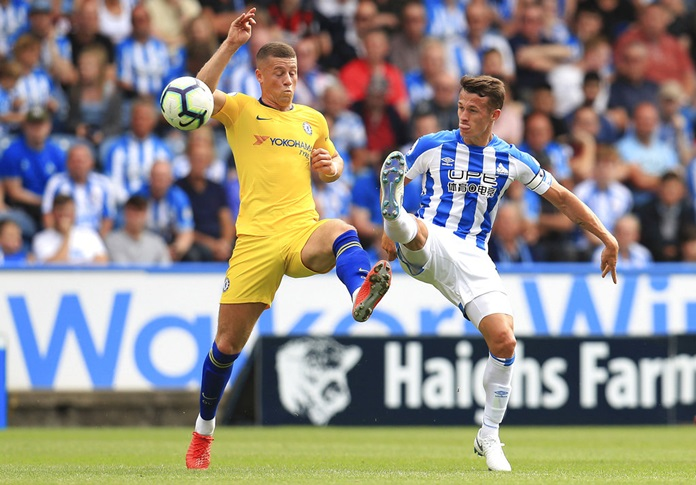 Chelsea's Ross Barkley, left, and Huddersfield Town's Jonathan Hogg in action during their English Premier League soccer match at the John Smith's Stadium in Huddersfield, Saturday Aug. 11. (Mike Egerton/PA via AP)