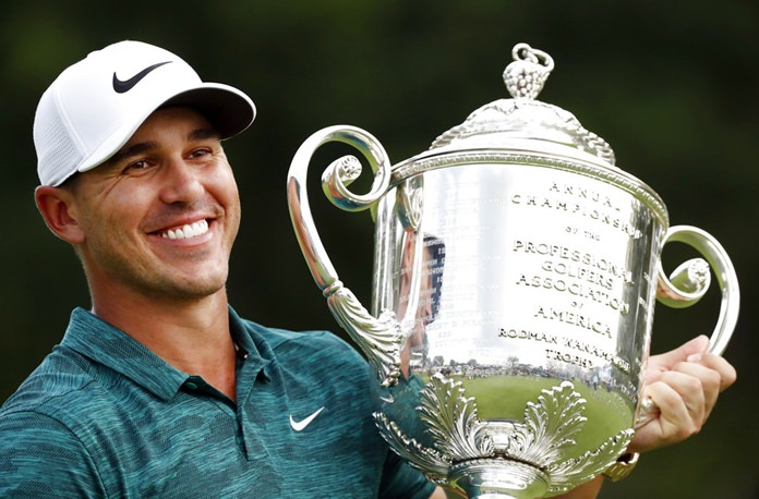 Brooks Koepka holds the Wanamaker Trophy after he won the PGA Championship golf tournament at Bellerive Country Club, Sunday, Aug. 12, in St. Louis. (AP Photo/Brynn Anderson)