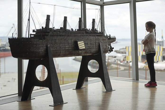 Aoise Taggert, aged nine, looks at a model of the Titanic at Titanic Belfast, Northern Ireland, Tuesday July 24. (Niall Carson/PA Wire(/PA via AP)