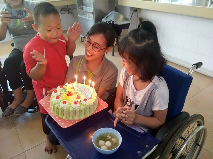 Fahsai's birthday cake brings joy to the entire home.