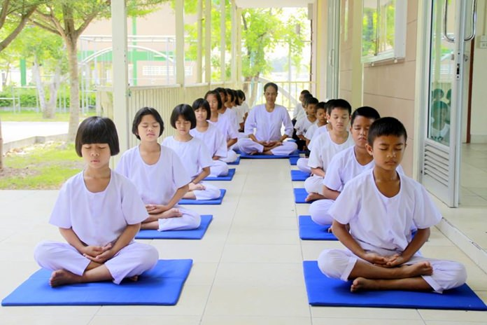 Radchada Chomjinda, Director of the Child Protection and Development Center (CPDC), Huay Yai, assigned staff to lead children under the Foundation's care to meditate for peaceful minds to dedicate to HM King Rama X on his 66th birthday and to pray for Lao citizens caught up in the broken dam disaster.