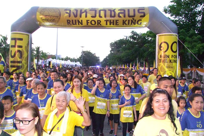 Thousands cross the start line outside the Governor's House in Chonburi city, Sunday, July 29, to take part in the special walk-run event to celebrate His Majesty the King's 66th birthday.