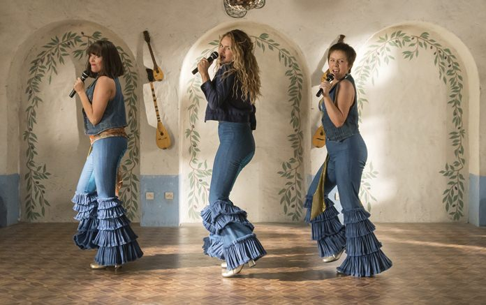 """This image shows (from left) Jessica Keenan Wynn, Lily James and Alexa Davies in a scene from """"Mamma Mia! Here We Go Again."""" (Jonathan Prime/Universal Pictures via AP)"""