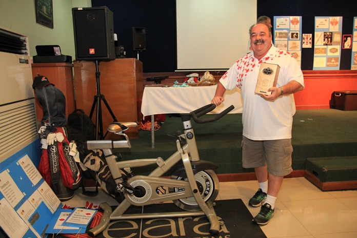 Jack Levy with his Royal Salute and exercise bike raffle prizes.