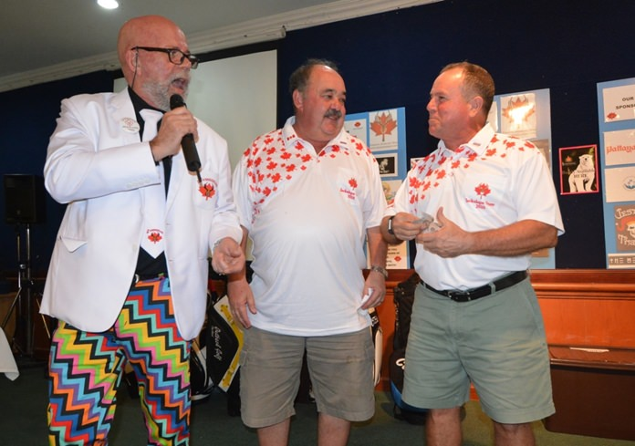 (L to R) Mark Gorda and Jack Levy reward the longest first putt prize, donated by Jack's Macallan Insurance, to winner Bill Collis who kindly donated 5,000 baht directly to the donation box.