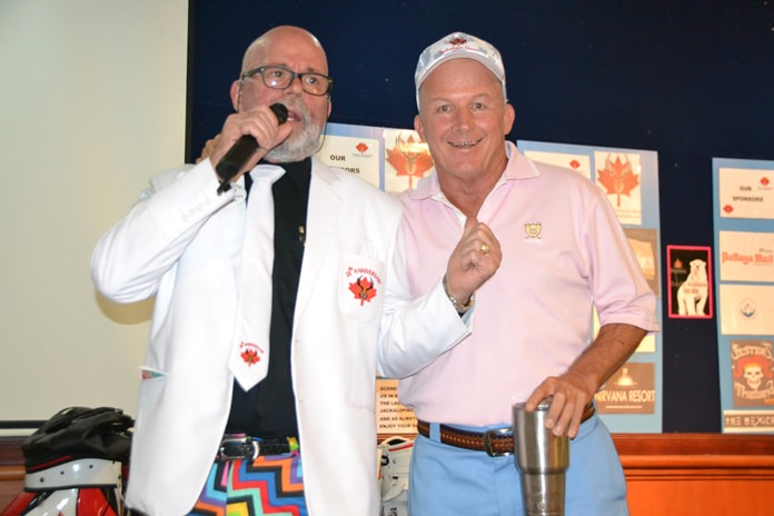 Mark Gorda, emcee and tournament organizer, thanks John Emerson for his invaluable help in running the tournament.