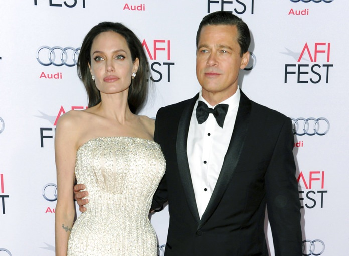 Angelina Jolie (left) and Brad Pitt are shown together in this Nov. 5, 2015 file photo. (Photo by Richard Shotwell/Invision/AP)