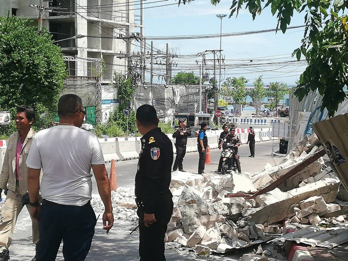 Debris from a building being demolished for encroaching on the South Pattaya canal spilled on to the Bali Hai interchange, blocking traffic, but causing no injuries.