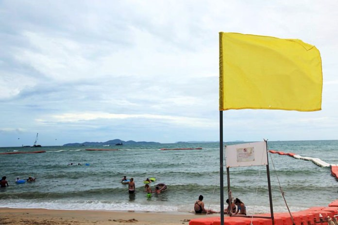 Yellow flags went up on Pattaya-area beaches to warn swimmers to take care when tropical storm Bebinca impacted the area.