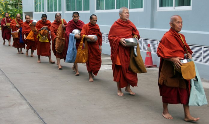 The Abbot leads the nine monks.