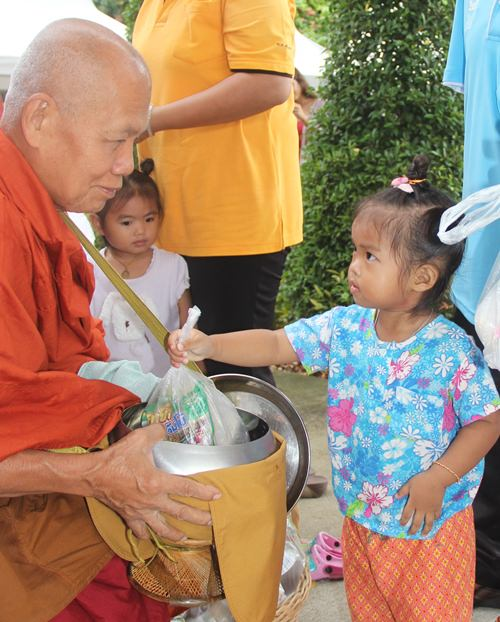 Never too young to give alms.