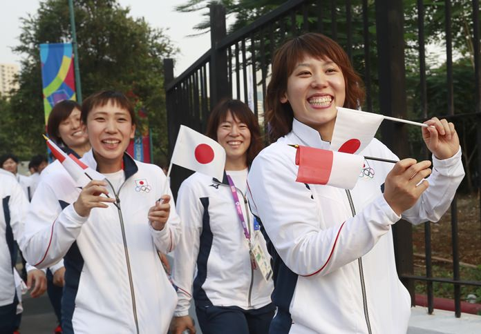 Japan's contingent prepares prior to the opening ceremony for the Asian Games in Jakarta, Saturday, Aug. 18. (AP Photo/Tatan Syuflana)