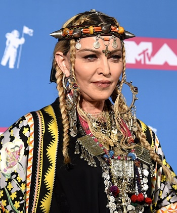 Madonna poses in the press room at the MTV Video Music Awards at Radio City Music Hall on Monday, Aug. 20, in New York. (Photo by Evan Agostini/Invision/AP)