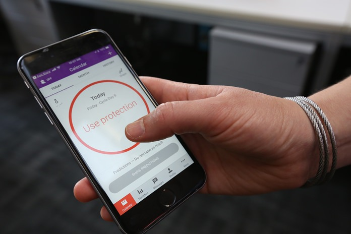 A women demonstrates using the Natural Cycles smartphone app in London, Friday, Aug. 17. The mobile fertility app has become the first ever digital contraceptive device to win FDA (US Food and Drug Administration) marketing approval. (AP Photo/Nishat Ahmed)