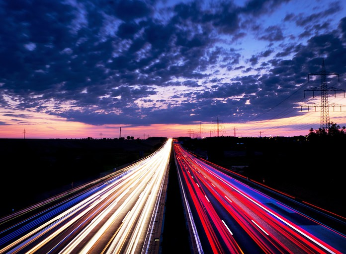 A long exposure picture shows driving cars on the highway just before sunrise near Frankfurt, central Germany on Friday, Aug. 17. (AP Photo/Michael Probst)