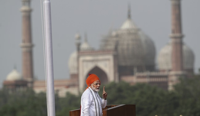 Indian Prime Minister Narendra Modi addresses the nation on the country's Independence Day from the ramparts of the historical Red Fort in New Delhi, India, Wednesday, Aug. 15, 2018. India will send a manned flight into space by 2022, Modi announced as part of India's Independence Day celebrations. (AP Photo/Manish Swarup)