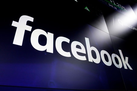 Federal regulators are alleging that Facebook's advertising tools allow landlords and real estate brokers to engage in housing discrimination. (AP Photo/Richard Drew, File)