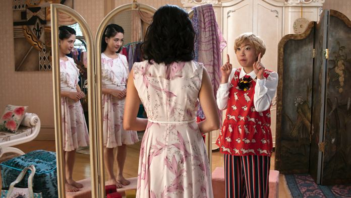 """This image shows Constance Wu (left) and Awkwafina in a scene from the film """"Crazy Rich Asians."""" (Warner Bros. Entertainment via AP)"""