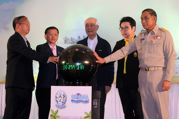 Former Prime Minister Anand Panyarachun, flanked by Department Deputy Commissioner Somchai Sumanatkajonkul and Rattanachai Sutidechanai, the ex-Pattaya councilman who now advises the Tourism and Sports Ministry, announce the rebuilding of Pattaya Beach will be completed by year-end.