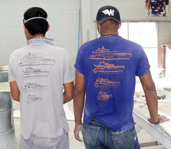 Apprentices wearing blue shirts are closely supervised by mentors and teachers.