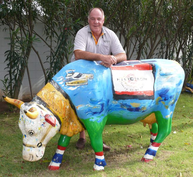 A true Swiss, Philippe stands proudly with one of his three saintly-painted cows grazing in the garden of Bakri Cono Shipyard.