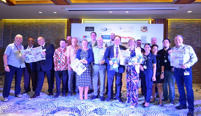 Representatives of the Joint Chambers in Thailand, sponsors and media partners join in for a group photograph, some holding a copy of the Pattaya Mail, the best English language newspaper in Pattaya and the Eastern Seaboard.