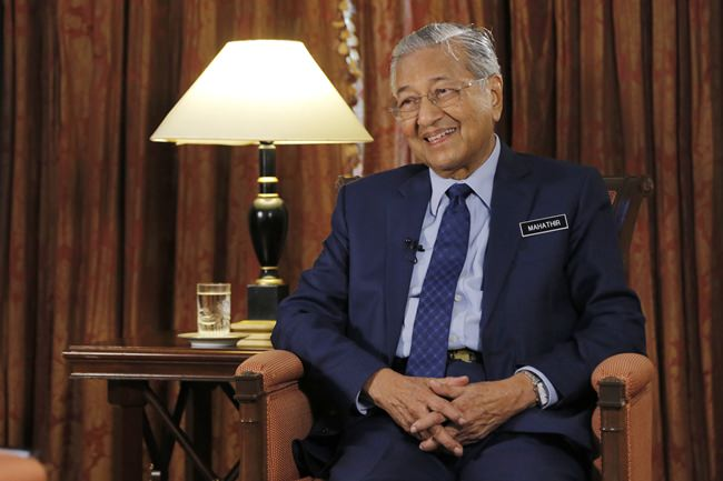 Malaysia's Prime Minister Mahathir Mohamad is interviewed in Putrajaya, Malaysia, Monday, Aug. 13. (AP Photo/Yam G-Jun)