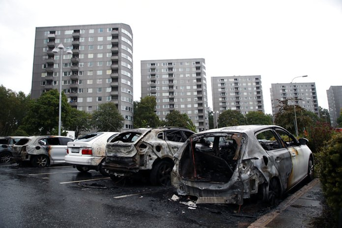 Burned cars are shown parked at Frolunda Square in Gothenburg, Tuesday, Aug. 14. (Adam Ihse/TT via AP)