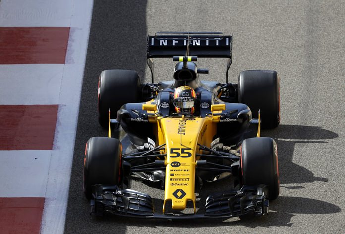 In this Friday, Nov. 24, 2017 file photo, Renault driver Carlos Sainz Jr. of Spain steers his car during the first free practice at the Yas Marina racetrack in Abu Dhabi, United Arab Emirates. (AP Photo/Luca Bruno)